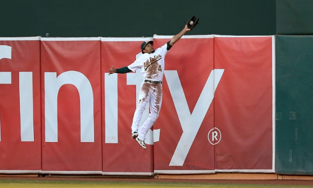 Coco Crisp climbs The Coliseum wall to rob Prince Fielder of a first inning home run.
