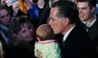 Another baby receives the Mitt Romney blessing outside the Cuyahoga Falls Natatorium in Cuyahoga Falls, Ohio