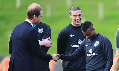 You naughty boy! Prince William jokes with Ashley Cole at St George's Park.