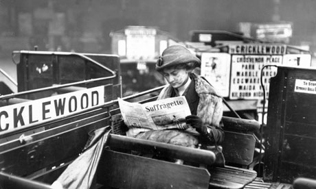 A woman on a bus in 1913 reading Suffragette magazine