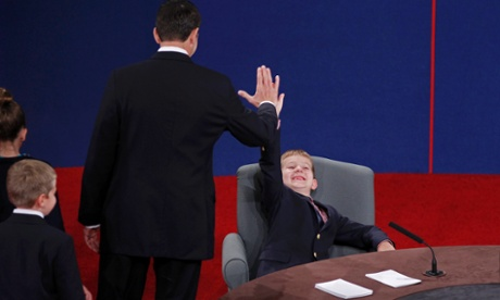 Paul Ryan high-fives his young son Sam, as he sits in one of the candidate's chairs after the conclusion of the vice presidential debate in Danville, Kentucky.