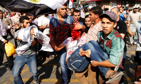 A wounded Egyptian protester is carried away from the site of clashes in Tahrir Square today. Photograph: AP/Mostafa el-Shemy
