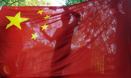 A demonstrator behind a China flag during a protest at the Japanese embassy in Budapest