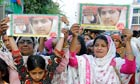 Pakistanis attend a rally condemning the Taliban's attack on Malala Yousafzai