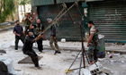 Free Syrian Army rebels launch a homemade bomb during clashes with pro-government soldiers in Aleppo