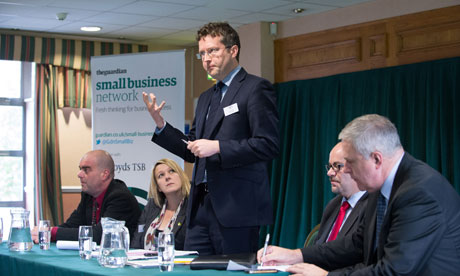 panel discussing business at conference