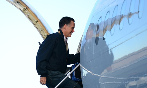 US Republican presidential candidate Mitt Romney and his wife Ann board his campaign plane in Bedford, Massaschusetts, October 16, 2012