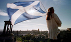 A woman flies the Scottish flag