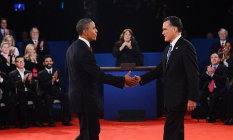 Candy Crowley applauds as Barack Obama shakes hands with Mitt Romney during the second presidential debate at Hofstra University.