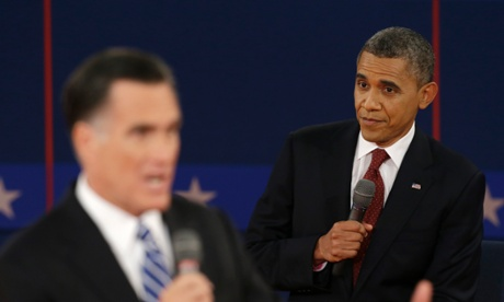 President Barack Obama listens as Republican presidential nominee Mitt Romney speaks during the second presidential debate at Hofstra University.