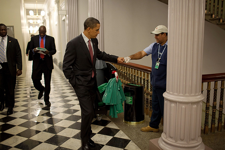 Obama by Pete Souza : 2009: Barack Obama fist-bumps custodian Lawrence Lipscomb