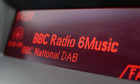 A car DAB radio display showing BBC Radio 6 Music