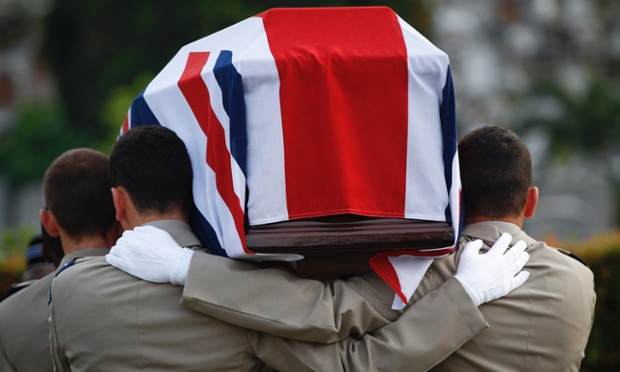 Officers of the British Royal Air Force (RAF) carry a coffin with the remains of a crew member whose plane crashed in the second world war at a burial ceremony in Kuala Lumpur, Malaysia. Eight British airmen have been buried with military honours in Malaysia, nearly 70 years after their plane crashed while on a mission there