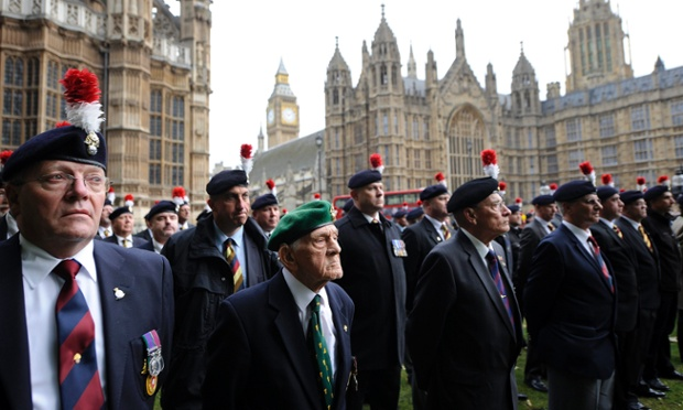 British army veterans protest outside Downing Street in London. Hundreds of veterans marched on parliament in protest at the government's decision to axe a battalion of the Royal Regiment of Fusiliers