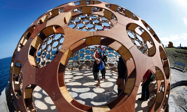 A visitor takes a photograph inside a work by artists Rachel Couper and Ivana Kuzmanovska titled Mirador at Sydney's Tamarama beach