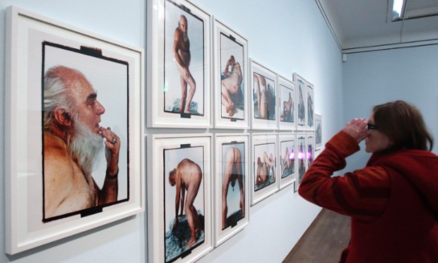 A visitor takes a closer look at a photographic series called Foxy Mister by Tomislav Gotovac during a preview of an art exhibition titled Nude Men at the Leopold museum in Vienna. The exhibition of around 300 art works is designed to show how the depiction of male nudity has evolved in art history