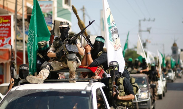 Hamas militants take part in a march through the streets of Gaza City, marking the anniversary of a prisoner swap deal between Israel and Hamas. Last year, Israel freed more than 1,000 jailed Palestinians in a swap for Gilad Shalit, an Israeli soldier who was being held in Gaza.