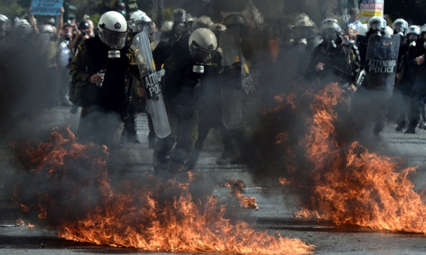 Greek riot police clash are surrounded my exploded molotov cocktails