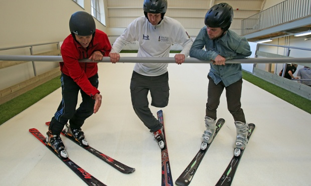 Cyclist Mark Cavendish (right) watches as skier Graham Bell (left) shows amputee Andy Barlow how to ski on the Skiplex slope that has been installed at the new Help for Heroes Tedworth House rehabilitation centre for wounded service personnel. The new facilities are part of a multimillion pound renovation project at Tedworth House which aims to inspire wounded, injured, sick and returning veterans to lead active, independent and fulfilling lives