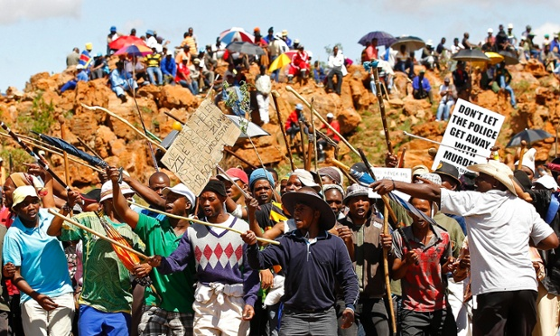 Striking miners chant slogans at the AngloGold Ashanti mine in Carletonville.