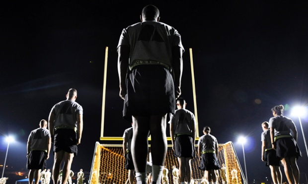 Soldiers stationed at the US Naval Base Guantanamo Bay in Cuba prepare for pre-dawn physical training in this photograph reviewed by the US Department of Defense.