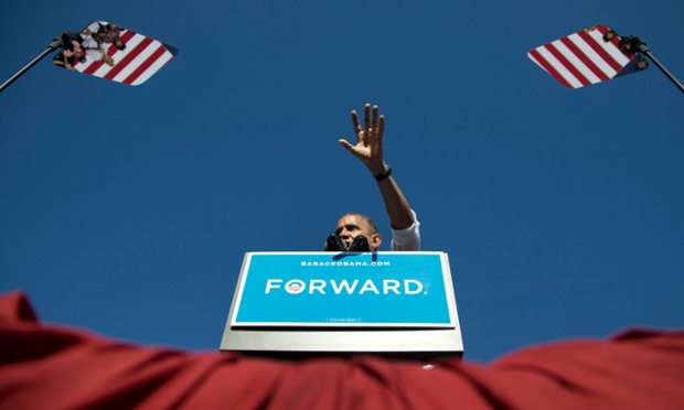 President Barack Obama gestures while speaking at a campaign event at Veteran s Memorial Park in Manchester, New Hampshire.