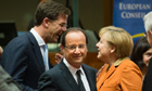 Francois Hollande and Angela Merkel at the EU summit in Brussels