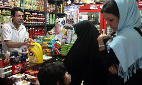 Women buy groceries in Tehran