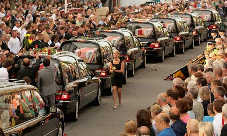 A cortege carrying the bodies of British soldiers killed in Afghanistan passes through Wootton Bassett in 2010. Photograph: Matt Cardy/Getty Images