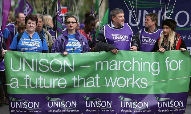 Unison trade union members take part in a TUC march to protest against government cuts in London