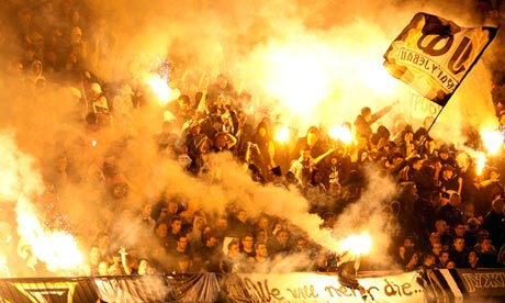 Red Star fans light flares during a game against Partizan in Belgrade