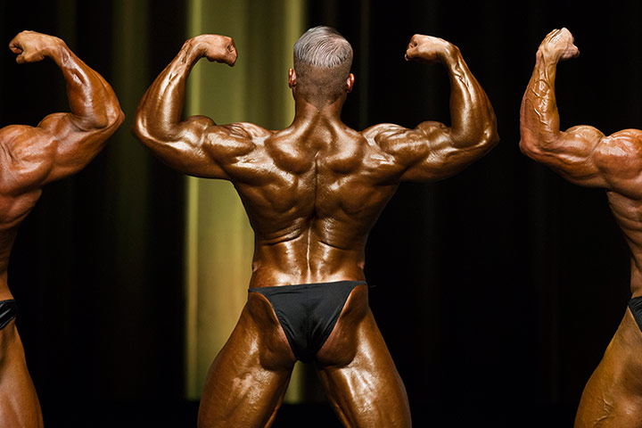Bodybuilding: Heavyweight bodybuilder Lukas Wyler performs next to other athletes