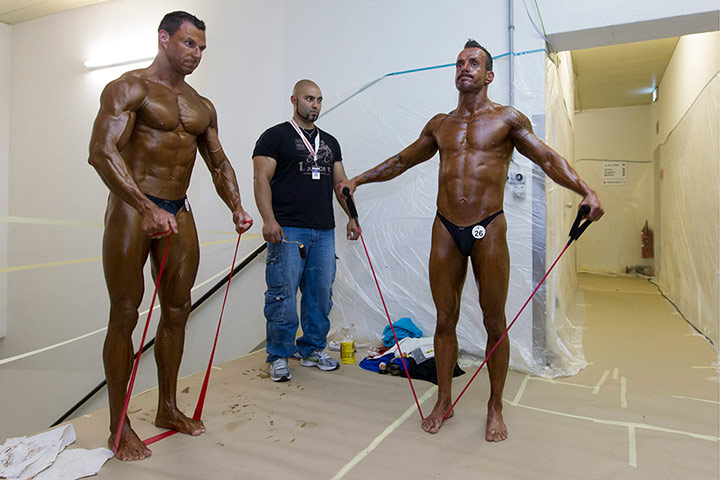 Bodybuilding: Bodybuilders warm up prior to their performances
