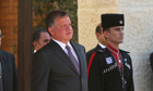 Jordan's King Abdullah to their national anthems respectively at the Royal Palace in Amman