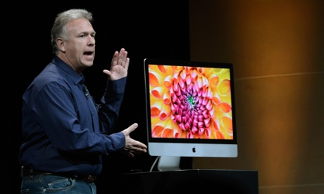 Apple senior vice president of worldwide product marketing Phil Schiller announces the new iMac during an Apple special event in San Jose.