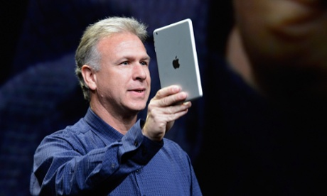 Apple product marketing boss Phil Schiller demonstrates the iPad Mini at an Apple event in San Jose.