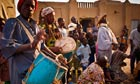 Musicians performing at the Crepissage festival in Timbuktu, Mali, in front of the Sankore mosque