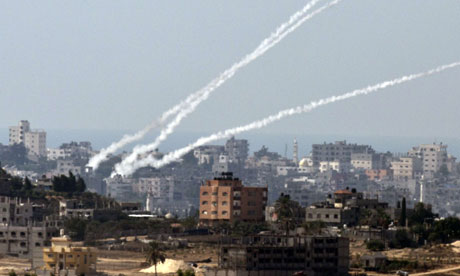 Rockets are launched from the Gaza Strip towards southern Israel on Wednesday. The rocket fire stopped overnight. Photograph: Jack Guez/AFP/Getty Images