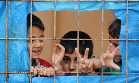 A Syrian child looks out from Yayladagi refugee camp in Hatay province on the Turkish-Syrian border