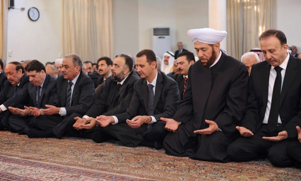 Syrian president Bashar al-Assad at Eid al-Adha prayers at the al-Afram Mosque in hte al-Muhajirin area in Damascus on Friday. A temporary truce between government and rebels on  the 4 days Muslim holiday of Eid al-Adha appears to be in the verge of collapse among a number of armed clashes.