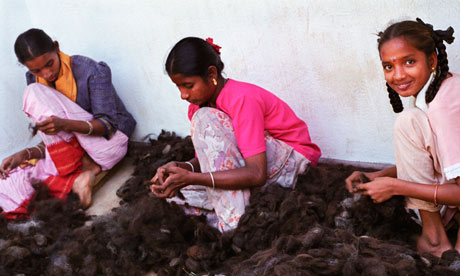 Women at work in a hair processing factory in India