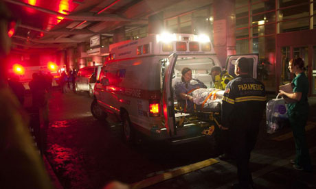 Paramedics evacuate patients from New York University Tisch hospital (Langone medical centre).