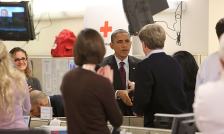 30 Oct 2012, Washington, DC, USA --- US President Barack Obama greets employeesat Red Cross headquarters Washington, DC, before speaking about ongoing relief in the wake of Hurricane Sandy, October 30, 2012.   --- Image by   CHRIS KLEPONIS/Corbis North America USA Washington, DC Mid-Atlantic