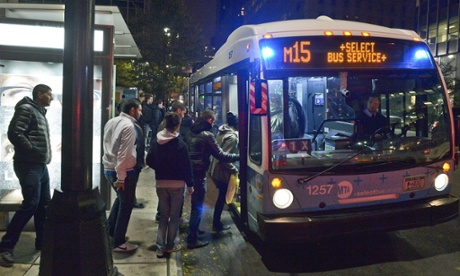 People board a New York City bus, as partial service was restored on Tuesday.