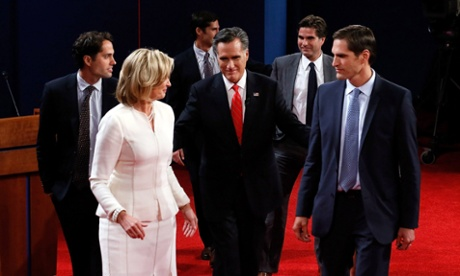 Mitt Romney, along with his family, walk off stage after the presidential debate.