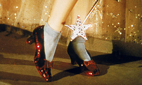Judy Garland wears the ruby slippers in The Wizard of Oz