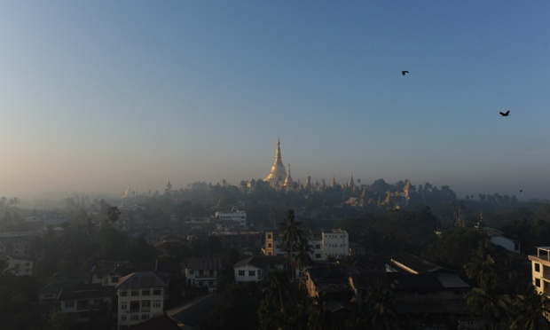 The sun rises over the Shwedagon pagoda in Yangon. Myanmar is emerging from ...