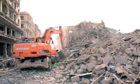 A digger working at the site of three explosions that rattled Saadallah al-Jabiri Square in Aleppo on Wednesday.