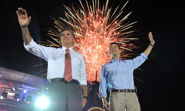 US Republican presidential candidate Mitt Romney and his running mate Paul Ryan wave as fireworks light up behind during campaign rally in Fishersville, Virginia.
