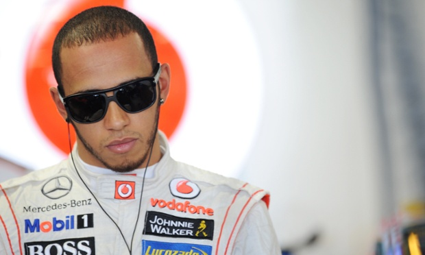 Deep in thought: Lewis Hamilton ahead of the Japanese Grand Prix practice.